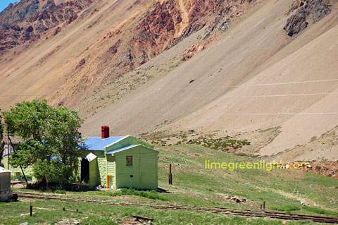 bright green house by old railway line in the Andes Argentina